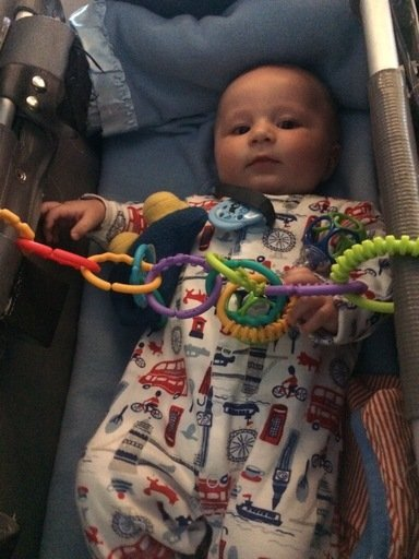 baby and toddler travel toys, flying with a baby, link toy being used on an airplane bassinet
