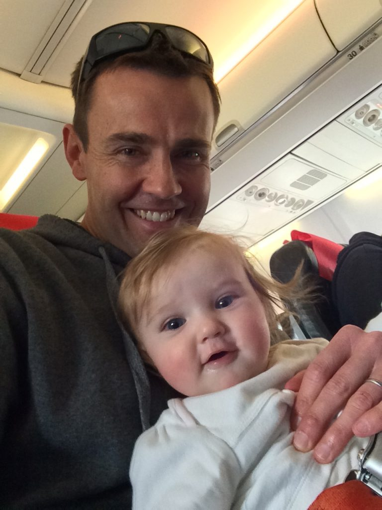 Flying With A Baby Tips, baby wearing an infant lap belt