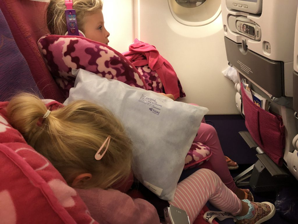 jet lag children on a plane. toddler sleep on plane