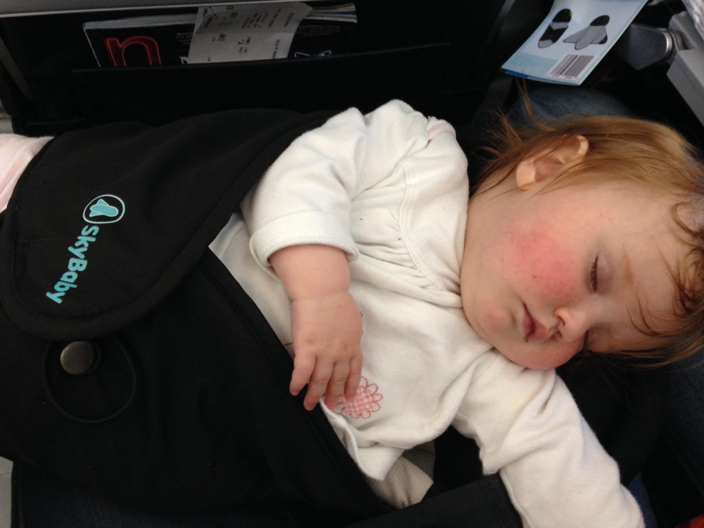 jet lag tips, Sleeping baby plane skybaby Sky baby. This is handy if you are flying with a baby and haven't got an airline bassinet or are flying short haul..