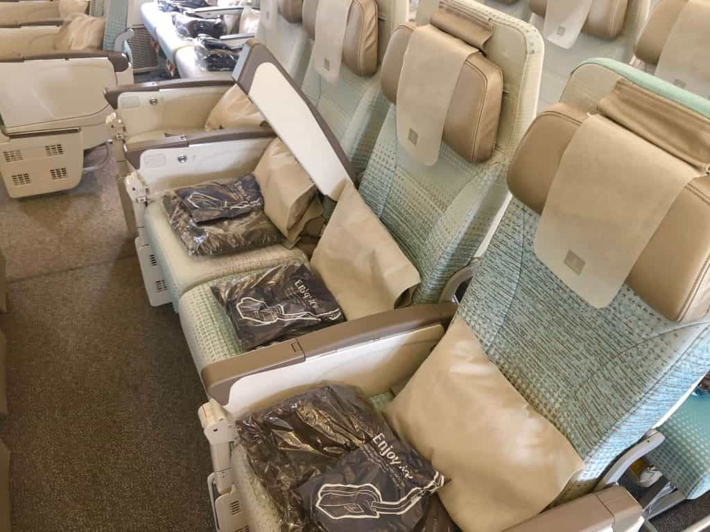 Emirates economy seats at the bassinet or bulkhead position on an airplane