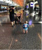 Al Maha services helping mother and baby at Doha Airport