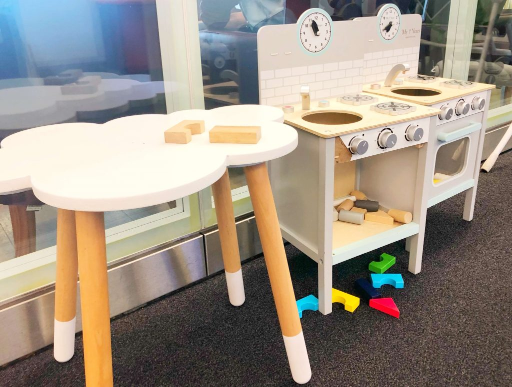 flying with a baby British airways, play area in the club lounge, wooden toy kitchen