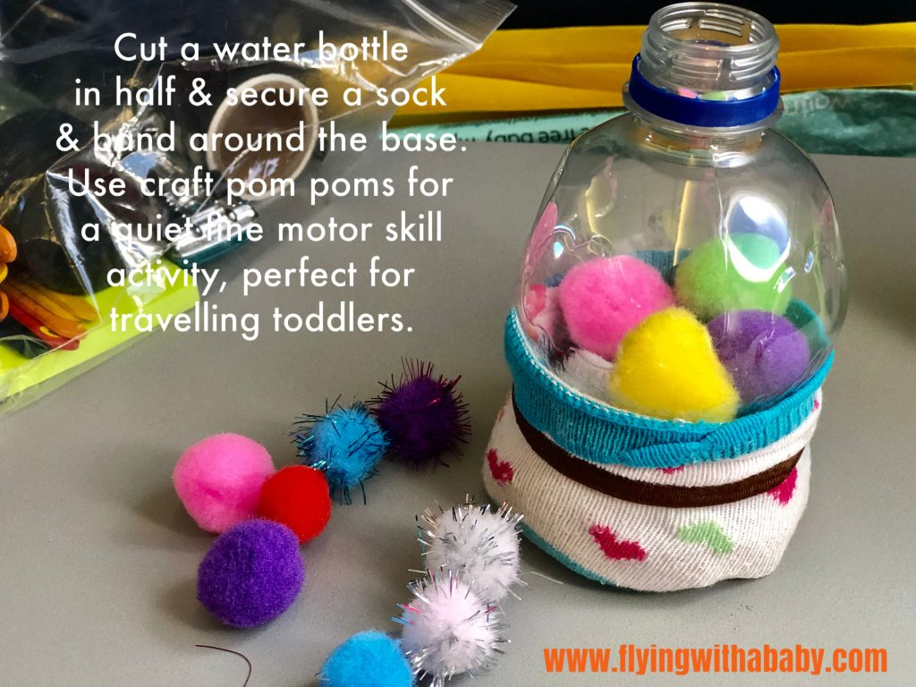 toddler travel toy wuth pom poms and a plastic bottle