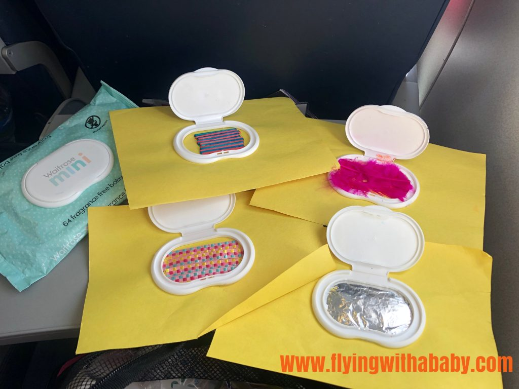 baby travel toy which is sensory. Use a baby wipes lid