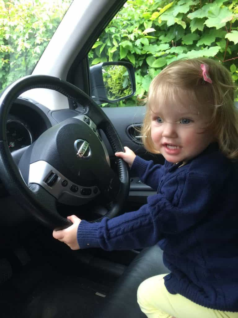 Car Activities for Toddlers, toddler by steering wheel