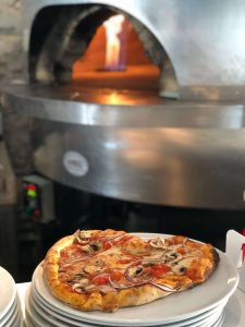 pizza making by pizza oven, Things to do in Lake Maggiore With Kids of all Ages  from Tots to Teens
