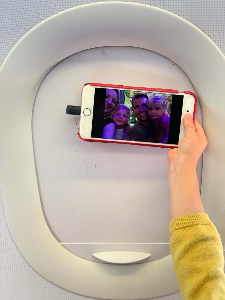 Travel Must Have's: Travel Tech Gadgets for Family Travel:  SanDisk iXpand flash drive on an iPhone.