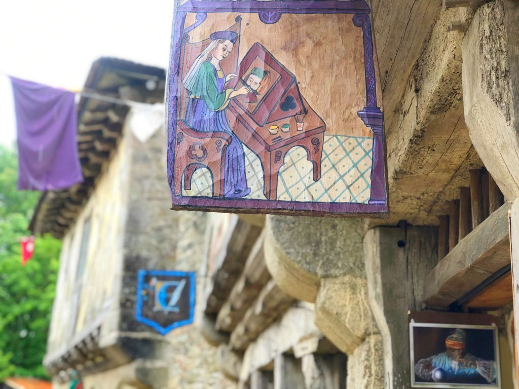 Puy du Fou with kids medieval village sign