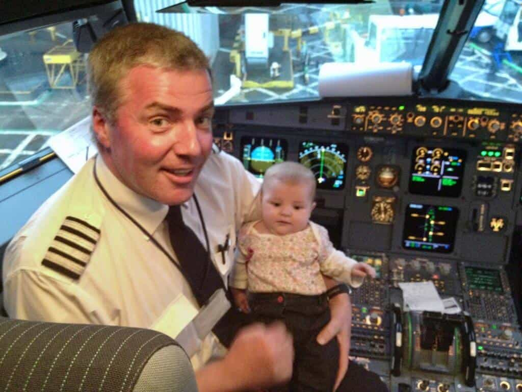 Flying With A Baby Tips - Top Tips from Booking to Arrival, baby in the flight deck, flying with a 3 month old baby
