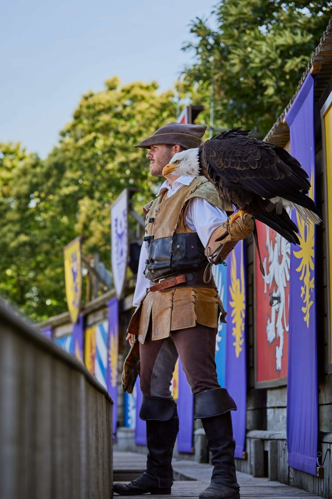 Puy du Fou with kids, man holding bird of prey