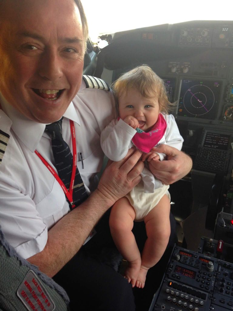 Flying With A Baby Tips - Top Tips from Booking to Arrival, baby in the fight deck