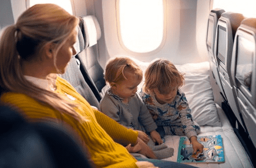 baby and toddler playing with a puzzle toy on the plane