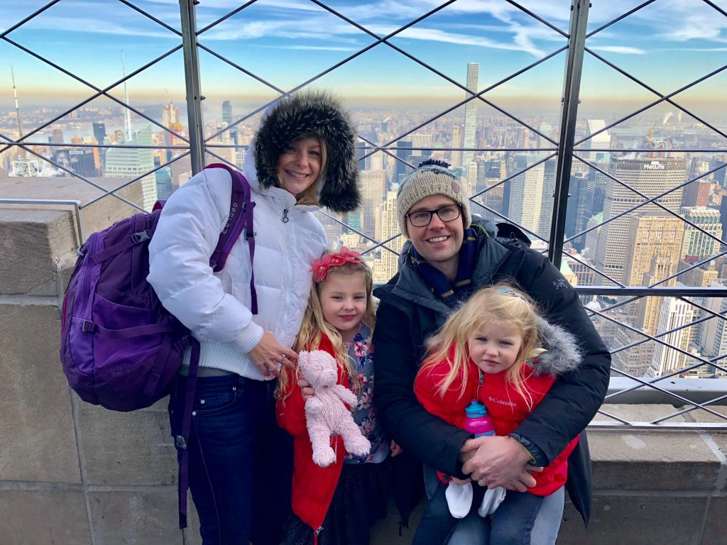 Family Enjoying the view on a freezing cold January morning - Empire State Building  - Things to do in New York in Winter With Kids