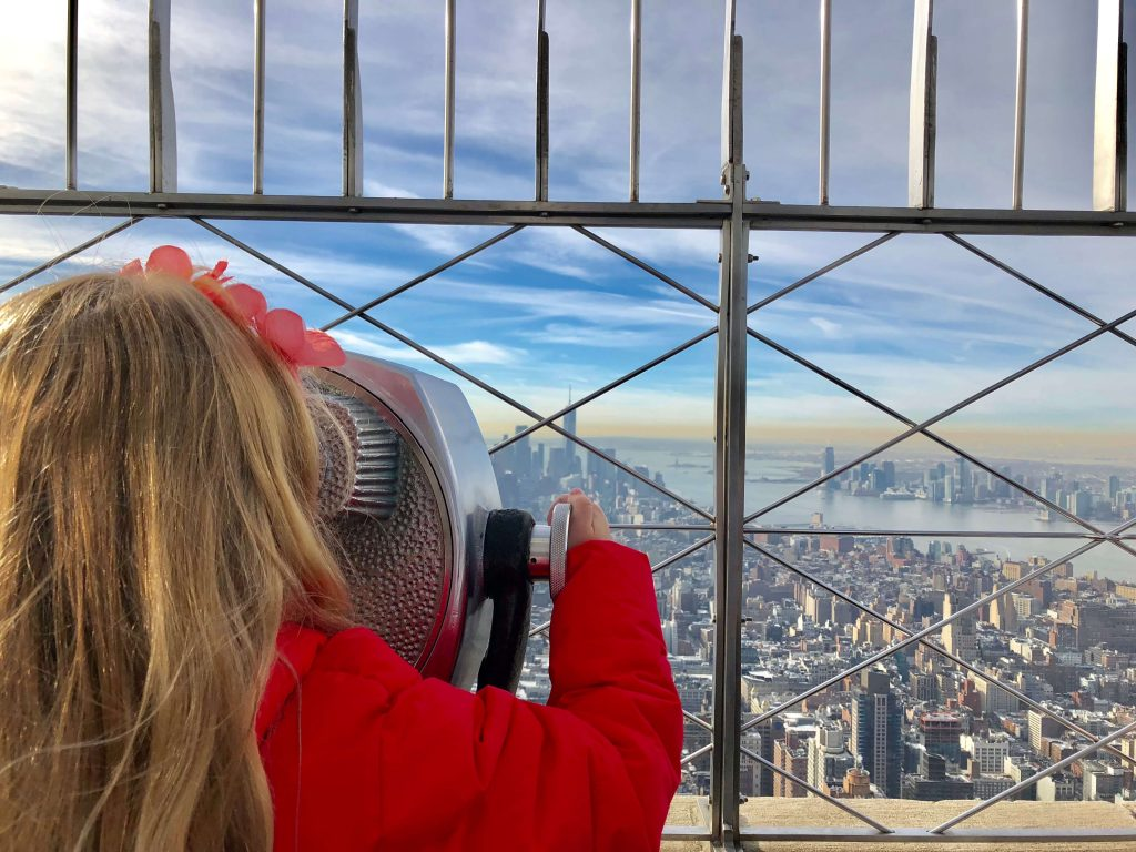 Things to do in New York in Winter With Kids  include voting the Empire State building and enjoying the view.