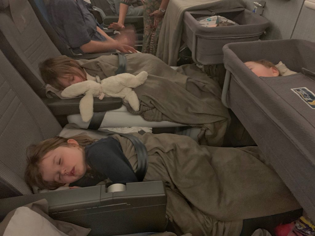 kids asleep on flyaway mattress and plane pal
