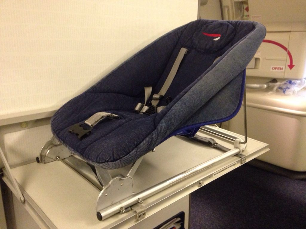 British Airways reclining chair airplane bassinet - photo copyright Carrie Bradley