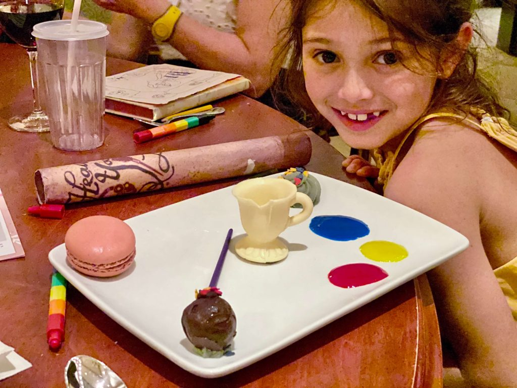 DIning at be Our Guest, Walt Disney World. The dessert was chip which you can paint with icing.