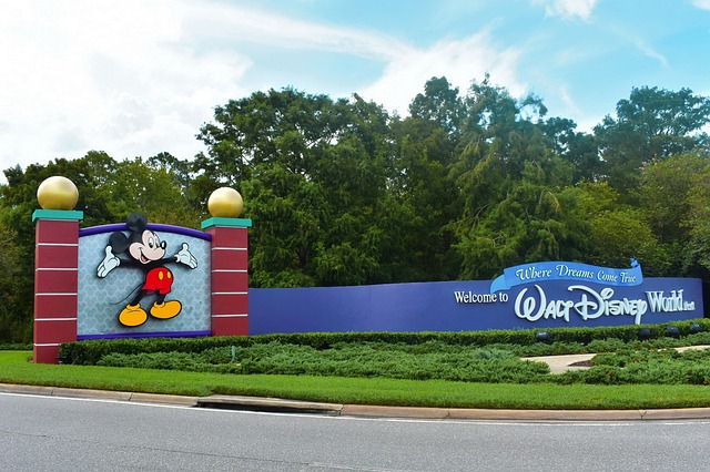 Walt Disney World sign - you will likely want to stay within reasonable distance of the parks and find the Perfect 2 Bedroom Suites in Orlando for Families