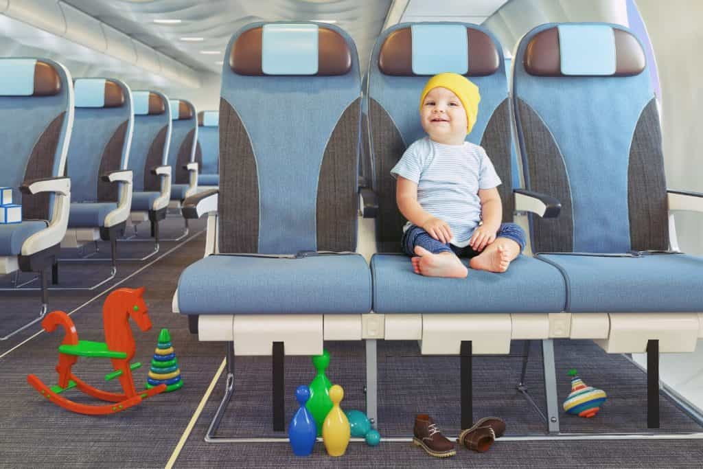 Which are the Best Airlines to Fly for families? baby on a plane with toys and acitivities
