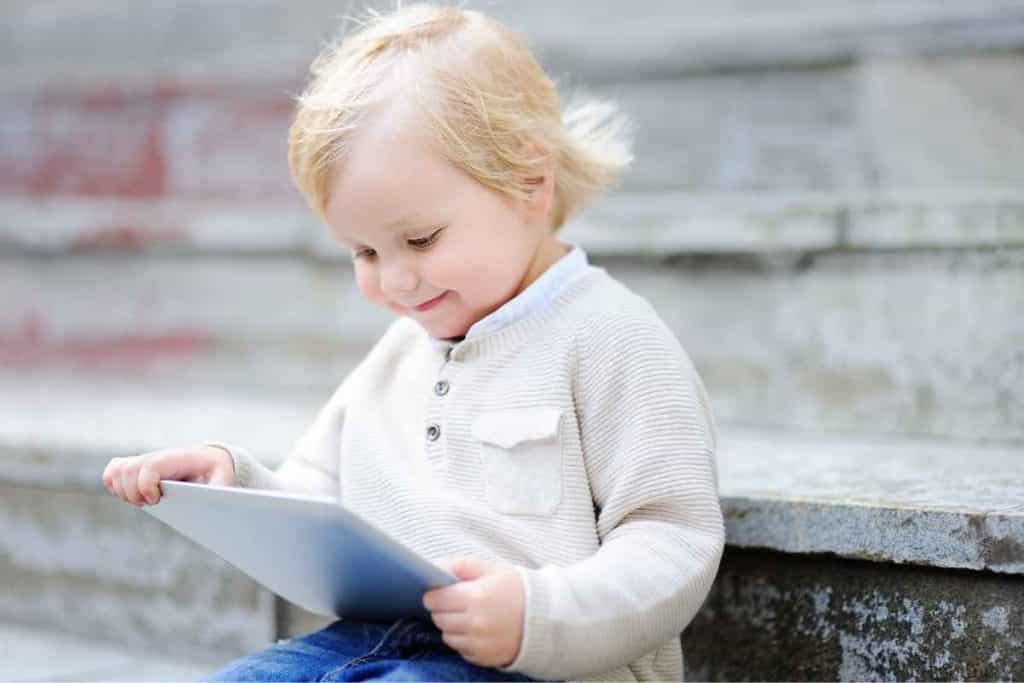 toddler with a Learning App on a tablet