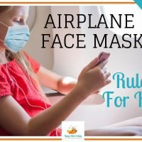 child wearing a face mask on a plane