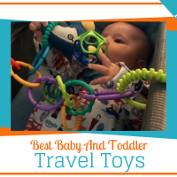 baby playing with a travel toy in an airline bassinet