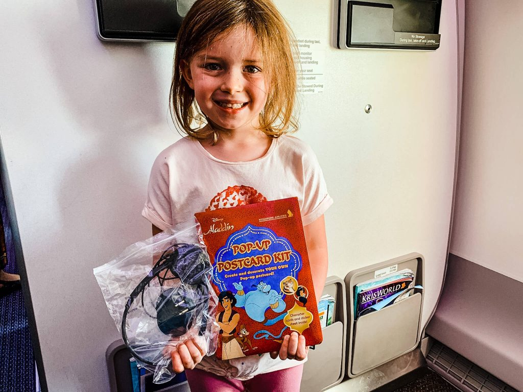 Singapore Airlines: Activity games and toys for infants and children providing on the flight. Best Airline Amenities for Kids